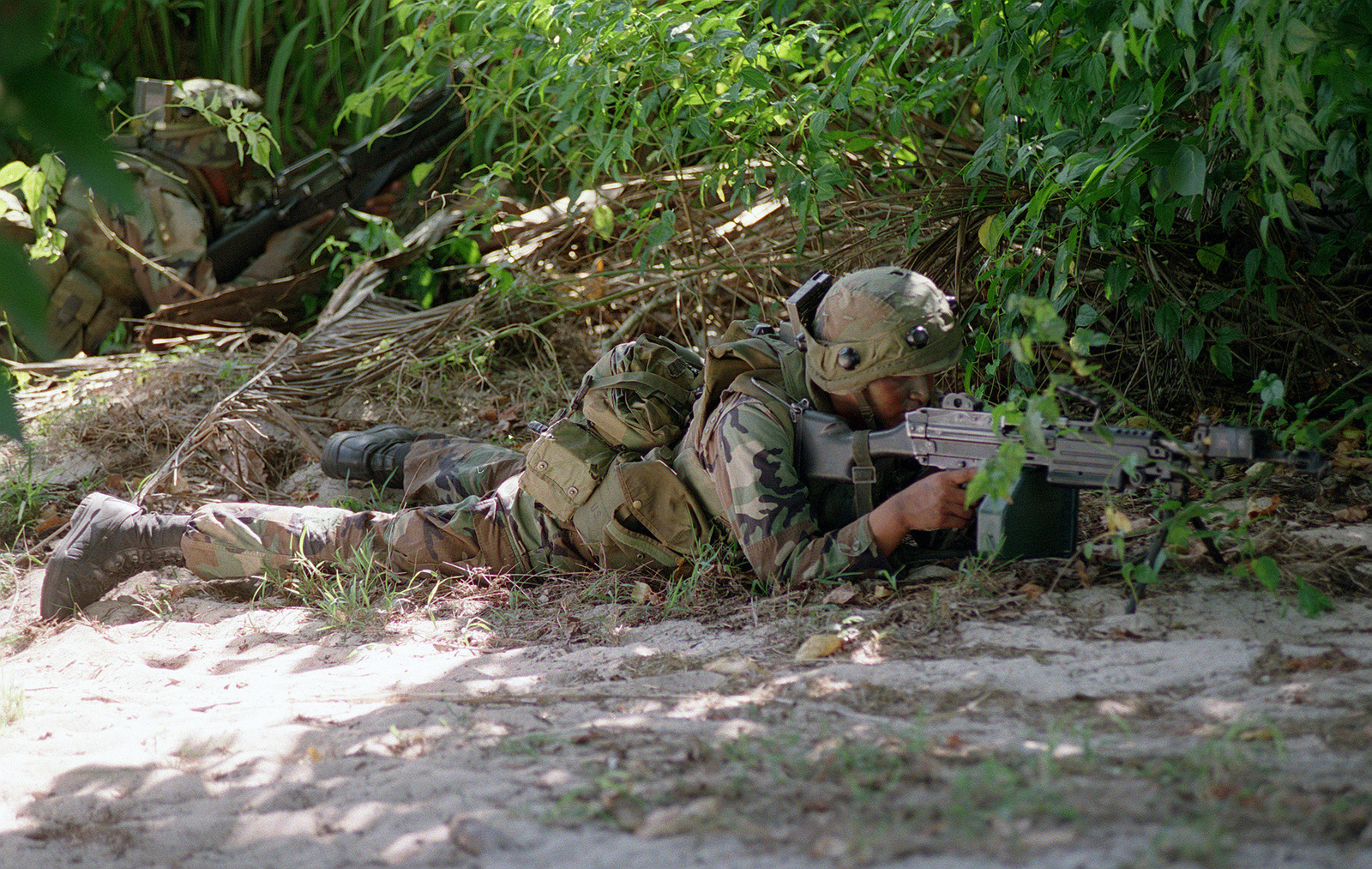 US Army Soldiers 1ST Battalion 17th Infantry One With A 556 Mm M249 Squad Automatic Weapon SAW Assume Defense Positions On Beach Tinian Island