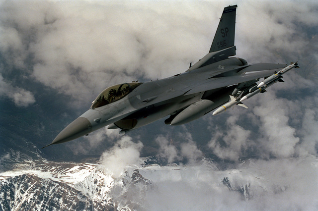 An F-16C Falcon from the 52nd Fighter Wing based at Spandahlem AB Germany breaks away from a 100th Air Expeditionary Wing KC-135R Stratotanker (not shown) from RAF Mildenhall United Kingdom on 31 Mar 99. While patroling the skies over Kosovo during Operation Allied Force, it is armed with AIM-120C missiles for self protection and Highspeed Anti Radiation Missiles on the inboard stations to suppress anti-aircraft radar sites