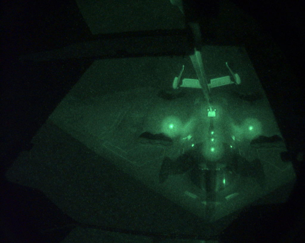 View from the boom operator's position on a KC-10 Extedner. A B-2 refuels from a KC-10 after completing a mission in support of NATO Operation Allied Force. This image was shot through a Starlight System