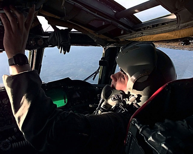 B-52H Stratofortress co-pilot from the 2 Air Expeditionary Group dials in radio frequencies as his crew prepares to launch cruise missiles at targets in Yugoslavia (not shown) in support of NATO Operation Allied Force.)