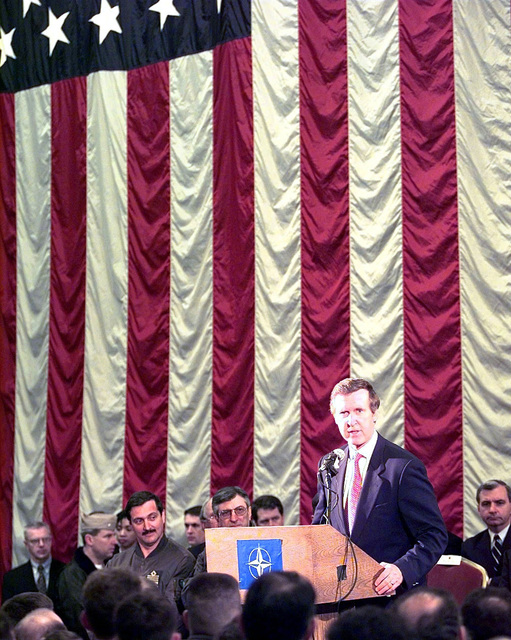 Defense Secretary William S. Cohen addresses personnel stationed and deployed to Aviano Air Base, Italy, supporting of NATO Operation Allied Force, on April 8, 1999