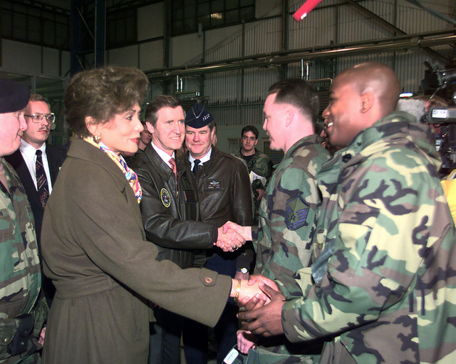 Secretary of Defense William Cohn and Mrs. Janet Langhart-Cohen and Secretary of Defense William Cohen greet members of the 37th Airlift Squadron during a brief stop at Ramstein Air Base, Germany, on April 8, 1999. Cohen thanked the personnel for the hard work and sacrifices they are making in support of NATO Operation Allied Force and Sustain Hope. He stressed the importance of our involvement in the current humanitarian relief efforts in Kosovo and Albania. Vice Chairman of Joint Chiefs of STAFF, U.S. Air Force GEN Joseph Ralston, is seen in the background