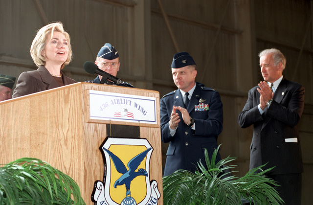 Right side front view, medium shot from the shoulders up at US First Lady Hillary Rodham-Clinton as she speaks to the men and women of Team Dover during her speech at Dover Air Force Base, Delaware on April 9th 1999