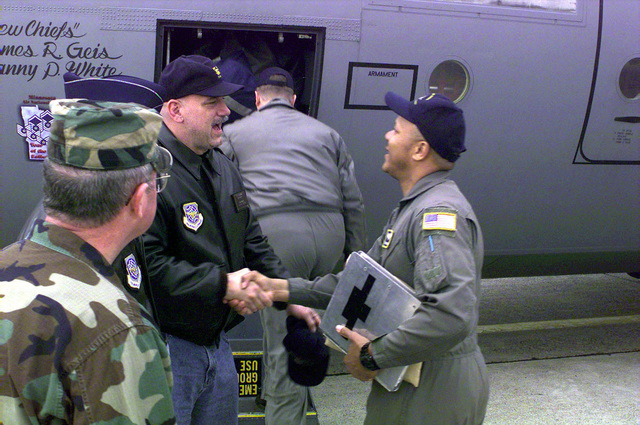 (From left to right) US Army BGEN Gary Le Blanc, Assistant Adjutant General, Minnesota Army and Air National Guard; US Air Force COL Terry Heggemeier, 133rd Airlift Wing, Minnesota Air National Guard; and Minnesota Gov. Jesse Ventura give their support to Air Force TSGT Byron Todd as he prepares to deploy to Ramstein Air Base, Germany