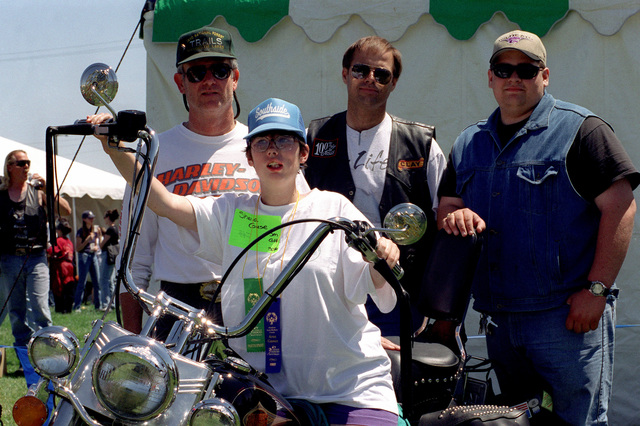 Sheila Guse sits on a Harley Davidson, put on display by the Santa Maria Hogs, during the Northern Santa Barbara County Special Olympics '99 held on April 17th, 1999 at Vandenberg Air Force Base, California. This image is seen in the April 1999 edition of AIRMAN Magazine