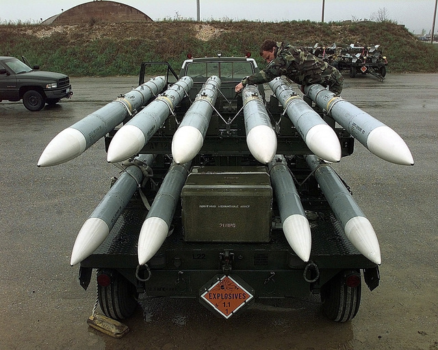 U.S. Air Force SSGT Allen Wesley secures a load of AIM-120s before transporting them to an aircraft. Wesley of Odessa, Texas, is assigned to the 31st Maintenance Squadron, Aviano Air Base, Itlay, supporting NATO Operation Allied Force