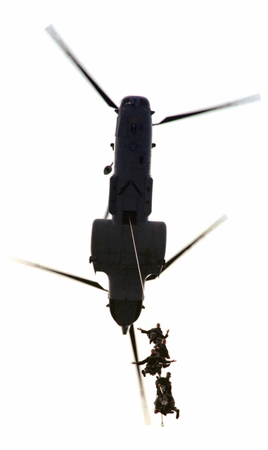 Dangling from a US Marine Corps (USMC) CH-46 Sea Knight helicopter, Marines with Force Reconnaissance Platoon, 13th Marine Expeditionary Unit (Special Operations Capable) (MEU (SOC)), SPIErig (Special Insertion Extraction rigging) in from a Helicast as part of the ongoing training to maintain readiness during WEST PAC 99-1. (SUBSTANDARD)