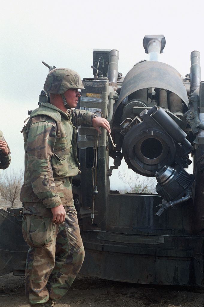 A marine from Bravo Battery, 1ST Battalion, 12th Marines, 3rd Marine Regiment awaits the next stage of fire with the breach open on a M198 155mm Towed Howitzer during a combined arms live fire exercise. The M198 is constructed of aluminum and steel, and is air transportable by CH-53E helicopter and C-130 or larger fixed-wing aircraft. Maximum effective range with conventional ammunition is 22,400 meters (13.92 miles) and with a rocket-assisted projectile, 30,000 meters (18.64 miles)
