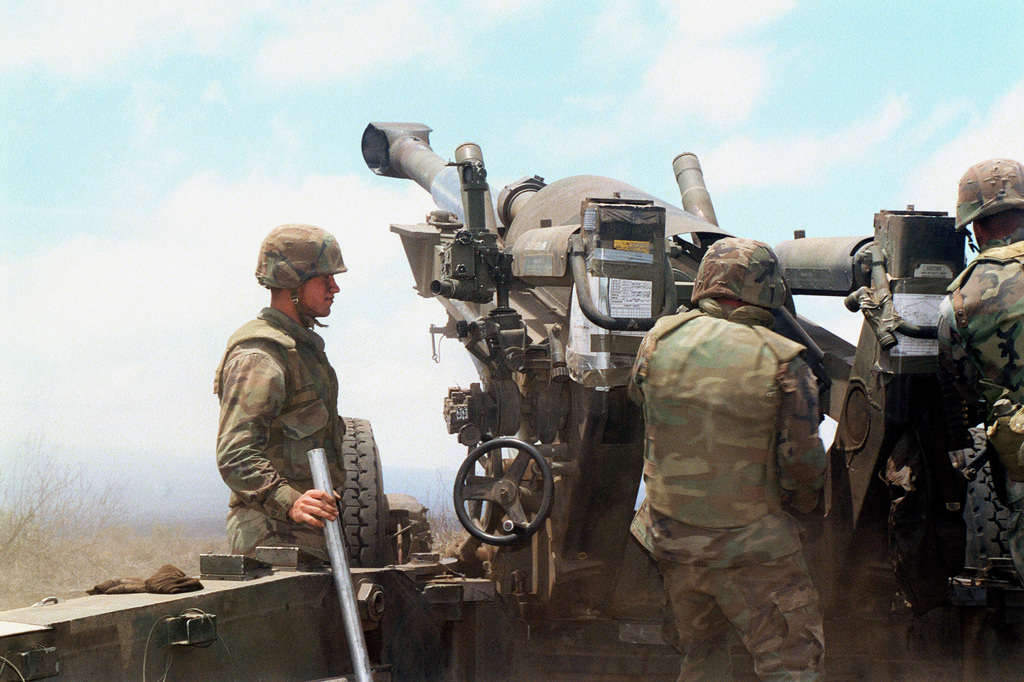 Marines from Bravo Battery, 1ST Battalion, 12th Marines, 3rd Marine Regiment insert a charge in a M198 155mm Medium Towed Howitzer to prepare for fire during a combined arms live fire exercise. The M198 is constructed of aluminum and steel, and is air transportable by CH-53E helicopter and C-130 or larger fixed-wing aircraft. Maximum effective range with conventional ammunition is 22,400 meters (13.92 miles) and with a rocket-assisted projectile, 30,000 meters (18.64 miles)