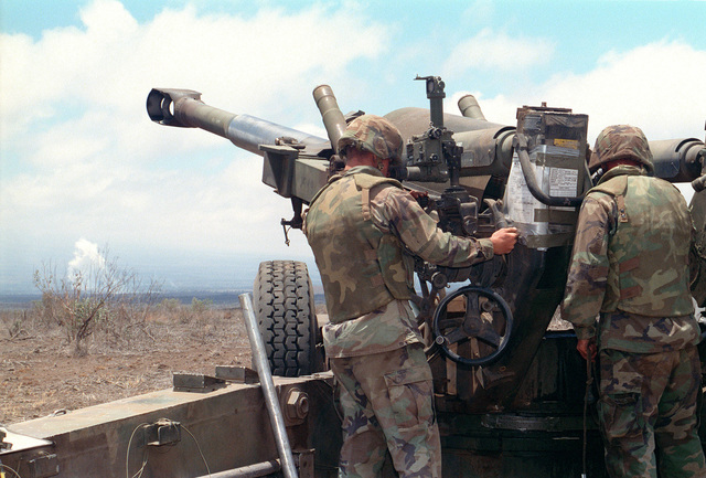 Marines from Bravo Battery, 1ST Battalion, 12th Marines, 3rd Marine Regiment make adjustments to a M198 155mm Medium Towed Howitzer during a combined arms live fire exercise. The M198 is constructed of aluminum and steel, and is air transportable by CH-53E helicopter and C-130 or larger fixed-wing aircraft. Maximum effective range with conventional ammunition is 22,400 meters (13.92 miles) and with a rocket-assisted projectile, 30,000 meters (18.64 miles)