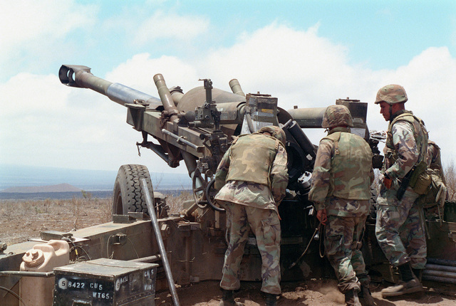 Marines from Bravo Battery, 1ST Battalion, 12th Marines, 3rd Marine Regiment make adjustments to a M198 155mm Towed Howitzer during a combined arms live fire exercise. The M198 is constructed of aluminum and steel, and is air transportable by CH-53E helicopter and C-130 or larger fixed-wing aircraft. Maximum effective range with conventional ammunition is 22,400 meters (13.92 miles) and with a rocket-assisted projectile, 30,000 meters (18.64 miles)