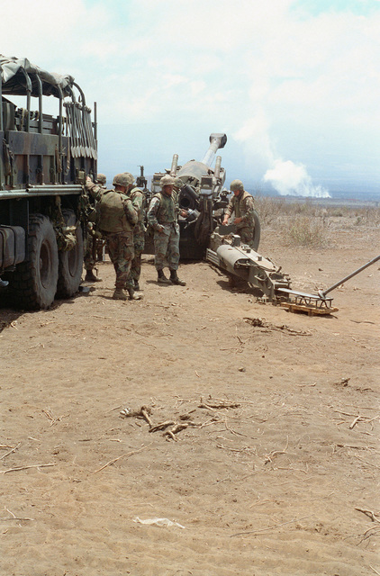 Marines from Bravo Battery, 1ST Battalion, 12th Marines, 3rd Marine Regiment make adjustments to a M198 155mm Medium Towed Howitzer during a combined arms live fire exercise on. The M198 is constructed of aluminum and steel, and is air transportable by CH-53E helicopter and C-130 or larger fixed-wing aircraft. Maximum effective range with conventional ammunition is 22,400 meters (13.92 miles) and with a rocket-assisted projectile, 30,000 meters (18.64 miles)