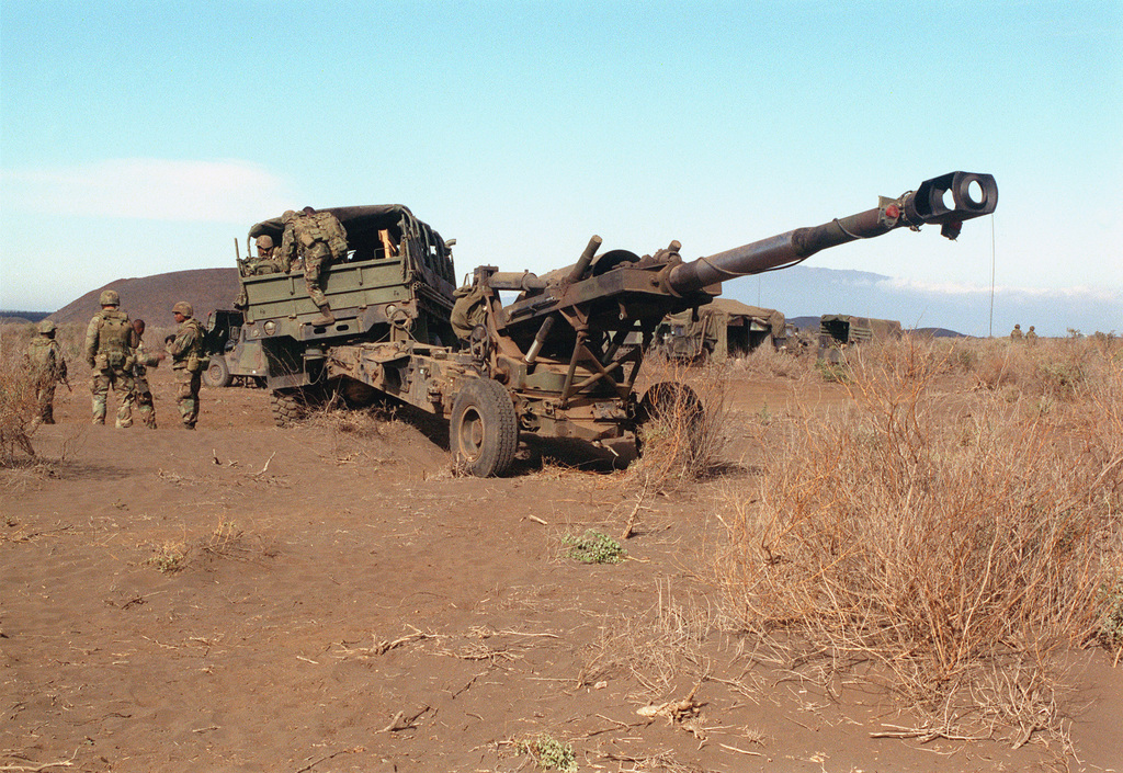 A M198 155mm Medium Towed Howitzer from Bravo Battery, 1ST Battalion, 12th Marines, 3rd Marine Regiment is moved into position during a combined arms live fire exercise. The M198 is constructed of aluminum and steel, and is air transportable by CH-53E helicopter and C-130 or larger fixed-wing aircraft. Maximum effective range with conventional ammunition is 22,400 meters (13.92 miles) and with a rocket-assisted projectile, 30,000 meters (18.64 miles)