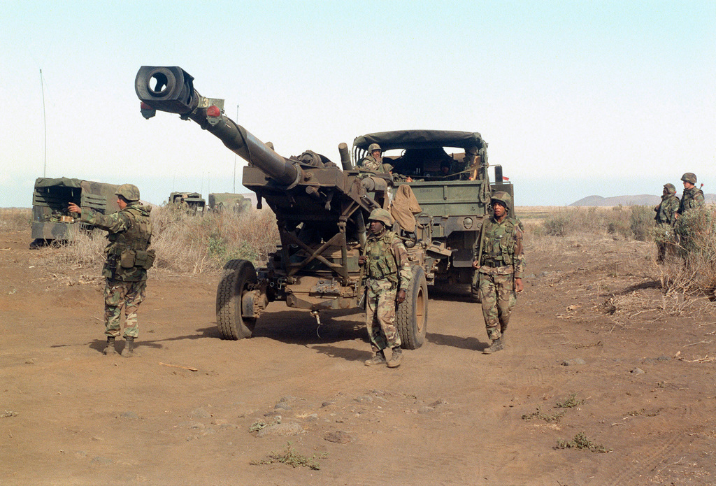A M198 155mm Medium Towed Howitzer from Bravo Battery, 1ST Battalion, 12th Marines, 3rd Marine Regiment is positioned with the aid of a M923 5-Ton Truck during a combined arms live fire exercise. The M198 is constructed of aluminum and steel, and is air transportable by CH-53E helicopter and C-130 or larger fixed-wing aircraft. Maximum effective range with conventional ammunition is 22,400 meters (13.92 miles) and with a rocket-assisted projectile, 30,000 meters (18.64 miles)