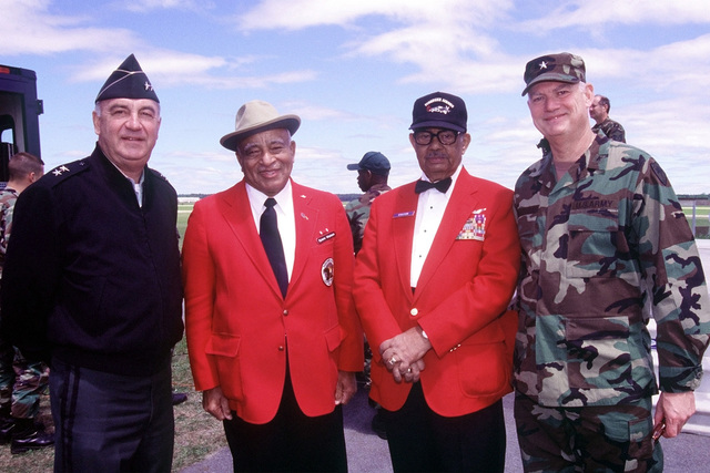 "Major General Stanhope S. Spears, Army National Guard (ARNG), Adjutant General, Military Department of South Carolina, (left) and Brigadier General Harry B. Burchstead Jr. , ARNG, Assistant Adjutant General, South Carolina Army National Guard (right), pose for a picture with two members of the ""Tuskeegee Airmen"" at the '99 Airshow at McEntire Air National Guard Base, South Carolina, 2 May 1999"