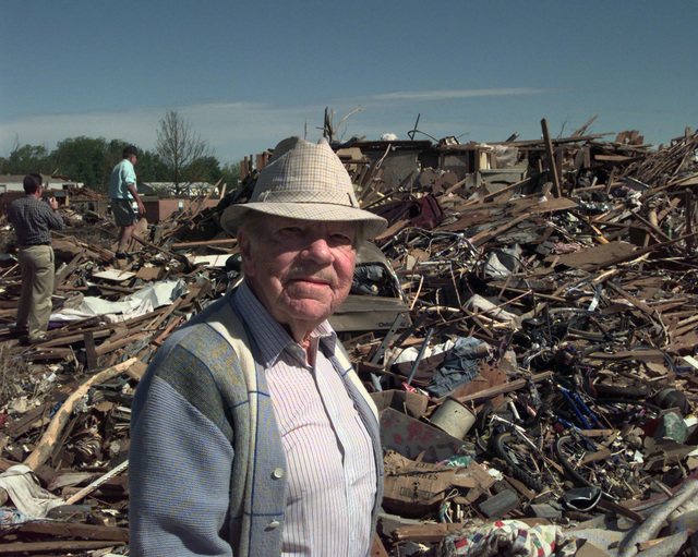 Cecil Millers house was devastated by an F-5 Tornado with winds up to 230 miles per hour. The area of destruction was 1 mile wide and and left a path of destruction 19 miles long. Mr. Miller stands in the foreground facing the camera. Two other gentlemen are seen in the background walking through the debris