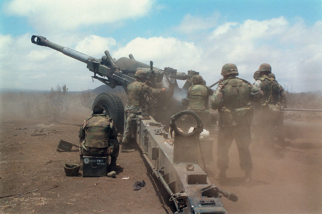 Marines from Bravo Battery, 1ST Battalion, 12th Marines, 3rd Marine Regiment fire a M198 Howitzer with a rocket assist projectile in connection with a combined arms live fire exercise. The M198 is constructed of aluminum and steel, and is air transportable by CH-53E helicopter and C-130 or larger fixed-wing aircraft. Maximum effective range with conventional ammunition is 22,400 meters (13.92 miles) and with a rocket-assisted projectile, 30,000 meters (18.64 miles)