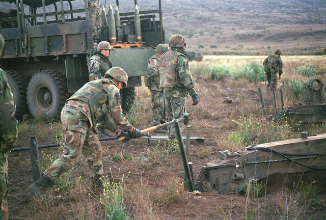 Marines from Bravo Battery, 1ST Battalion, 12th Marines, 3rd Marine Regiment prepare a M198 155mm Medium Towed Howitzer for rocket assist projectiles during a combined arms live fire exercise. The M198 is constructed of aluminum and steel, and is air transportable by CH-53E helicopter and C-130 or larger fixed-wing aircraft. Maximum effective range with conventional ammunition is 22,400 meters (13.92 miles) and with a rocket-assisted projectile, 30,000 meters (18.64 miles)