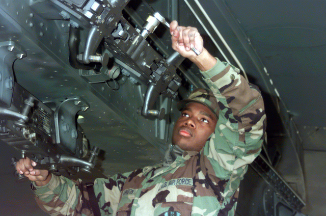 SRA Lamont Harrison performs maintainence on a B-52H weapons pylon at Royal Air Force Fairford, England on May 4, 1999. Harrison is a member of a weapons load team from Barksdale Air Force Base, Louisiana, and is forward deployed to RAF Fairford in support of NATO Operation Allied Force