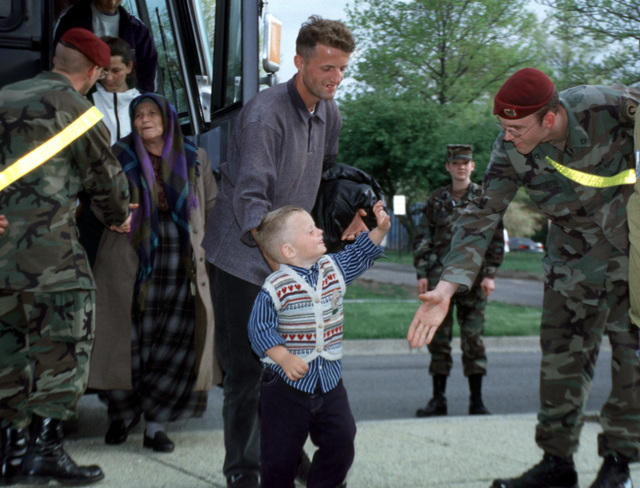 Kosovar refugees inprocess at the Immigration and Naturalization Center (not shown) at Fort Dix, New Jersey. Refugees arrived at McGuire Air Force Base, New Jersey, on May 5, 1999. This mission is in direct support of Operation Sustain Hope
