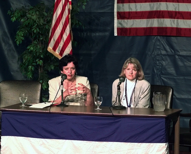 Lavinia Limon, Director of Health and Human Services Office of Refugee Resettlement, left, and Jan Belz, State Department Domestic Refugee Resettlement Program field questions from the local and national media concerning the status and morale of the 453 Kosovar refugees (not shown) who were flown into Fort Dix, New Jersey, on May 5, 1999. Both individuals are at Fort Dix to aid Joint Task Force Open Arms which is responsible for ensuring the refugees are properly processed and taken care of until sponsor families can be found for them. Open Arms is part of Operation Sustain Hope, the U.S. effort to bring in food, water, medicine, relief supplies, and to establish camps for the refugees...