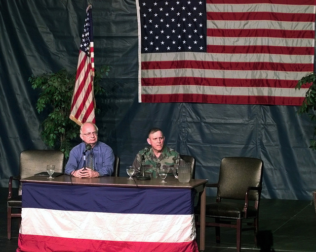 Roger Winter, Executive Director of Immigration and Refugee Services of America, and SGM Steven Woods, of the U.S. Army Reserve Command, field questions from the local and national media concerning the status and morale of the 453 Kosovar refugees (not shown) who were flown into Fort Dix, New Jersey, on May 5, 1999. Both individuals are at Fort Dix to aid Joint Task Force Open Arms which is responsible for ensuring the refugees are properly processed and taken care of until sponsor families can be found for them. Open Arms is part of Operation Sustain Hope, the U.S. effort to bring in food, water, medicine, relief supplies, and to establish camps for the refugees fleeing from the Former...
