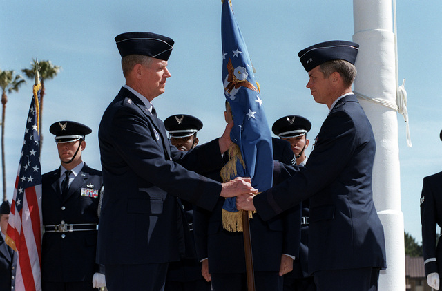 US Air Force Major General Gerald Perryman Jr., (Right) passes the flag to General Richard B. Meyers, Air Force Space Command and US Space Command Commander, relinquishing his command of the 14th Air Force. The 14th Air Force Change of Command took place May 6th, 1999, in front of the Headquarters Building on Vandenberg Air Force Base, California
