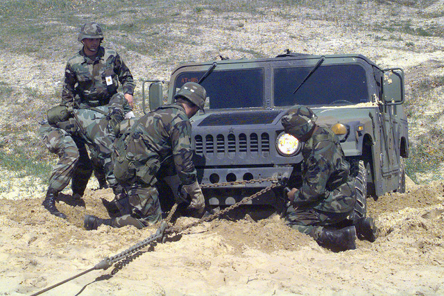 US Army students from 8th Battalion, 84th Regiment, 4th Brigade, 84th Division, Fort McCoy, Wisconsin, institutional training practice recovery of a High-Mobility Multipurpose Wheeled Vehicle (HMMWV) to become qualified for 88M Military Occupation Specialty