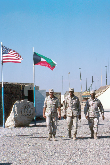 """A tour at Ali Al Salem Air Base, nicknamed the """"Rock"""", is a bonding experience, and nearly everyone who deploys comes home with a picture of the base's namesake trademark, """"The Rock"""". The rock is home of the 9th Air Expeditionary Group made up of over 1500 people and sits just 39 miles from the Iraq border. This photo is part of the """"On the Borderline"""" story in the July 1999, AIRMAN Magazine. The article describes life at the """"Rock"""" and how it's mission and personnel have increased since the end of the Persian Gulf War under OPERATION SOUTHERN WATCH"""