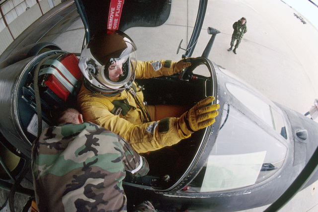Captain Christopher Burns with the 1ST Reconnaissance Squadron is prepped for his first solo high-altitude flight by squadron aerospace physiologists before starting engines. AIRMAN Magazine article describes the U-2 as still being a major player in the nation's reconnaissance mission despite its 1950s' design and first flight in 1955. Capable of then flying over 70,000 feet, and now even higher thanks to a new F-118-101 engine and upgraded avionics the aircraft was awarded the Collier Trophy in 1998 by the National Aeronautic Association and named the U-2S. The U-2S now has digital capabilty and can transmit data instantaneously to analysts at Beale AFB by using a network of ground ...