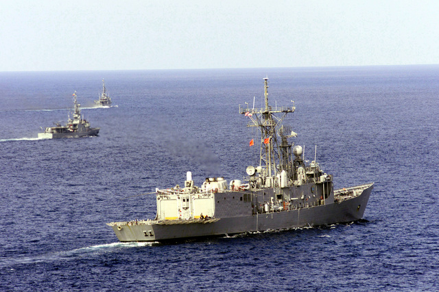 USS REUBEN JAMES (FFG 57 ) (center foreground) and two Ecuadorian vessels, LOS RIOS (CM 13) and ESMERALDAS (CM 11) conduct training exercises off the coast of Ecuador. Reuben James is en route to the bilateral exercise, TEAMWORK SOUTH '99. Reuben James will be conducting bilateral operations with the Chilean navy