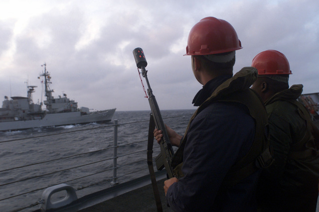 A deck-hand from USS REUBEN JAMES (FFG 57) prepares to shoot a line to a Peruvian navy vessel during a training operation off the coast of Peru. Reuben James was en route to Exercise TEAMWORK SOUTH '99. Due to high seas, the shot line evolution pictured here was cancelled. Reuben James will be conducting bilateral operations with the Chilean navy