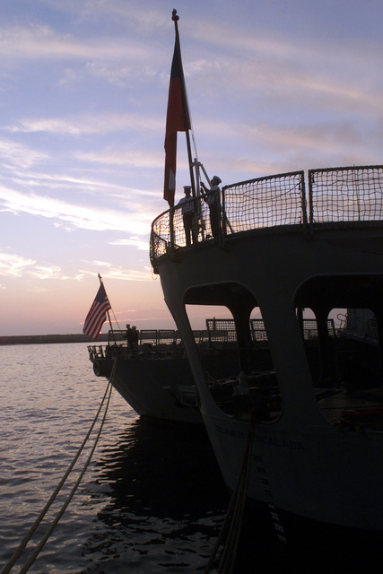 The Chilean flagship BLANCO ENCALADA (DLH 15) prepares to conduct the ceremonial lowering of their nations flags while in the port city of Antofagasta, Chile, during Exercise TEAMWORK SOUTH '99