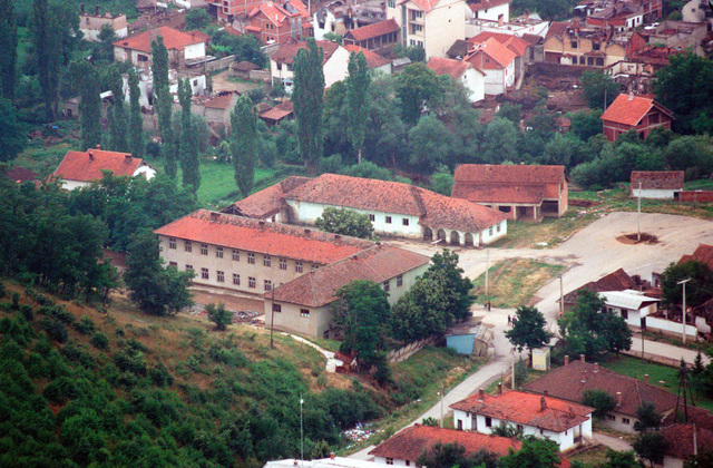 Aerial view of Lima Battery, 3rd Battalion, 10th Marine Regiments compound in an old school house in the village of Zegra, Kosovo. They are part of the Marines and sailors of the 26th Marine Expeditionary Unit (MEU) that are helping to enforce the implementation of the military technical agreement and to provide peace and stability to Kosovo during Operation JOINT GUARDIAN