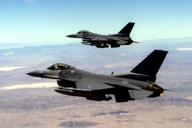 Two 169th Fighter Wing F-16C Falcons, Block 52, aircraft from McEntire Air National Guard Station, South Carolina, participate in a Miniature Air-Launched Decoy (M.A.L.D.) exercise at Nellis Air Force Base, Nevada. The exercise began on July 2nd, 1999. The South Carolina Air National Guard is the only reserve/guard unit to receive this high-profile mission known as Supression of Enemy Air Defenses (S.E.A.D.)