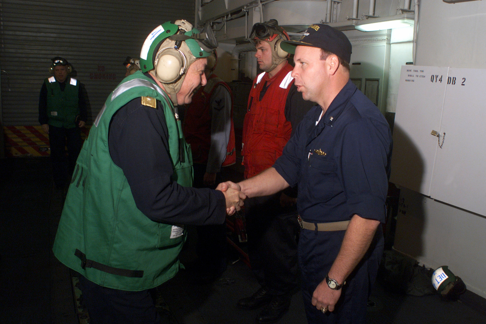 US Navy Commander Steven L Richter (right) Commanding Officer of USS REUBEN JAMES (FFG 57), greets Chilean Admiral Miguel Vergiara Villalobos during Exercise TEAMWORK SOUTH '99 while off the coast of Chile