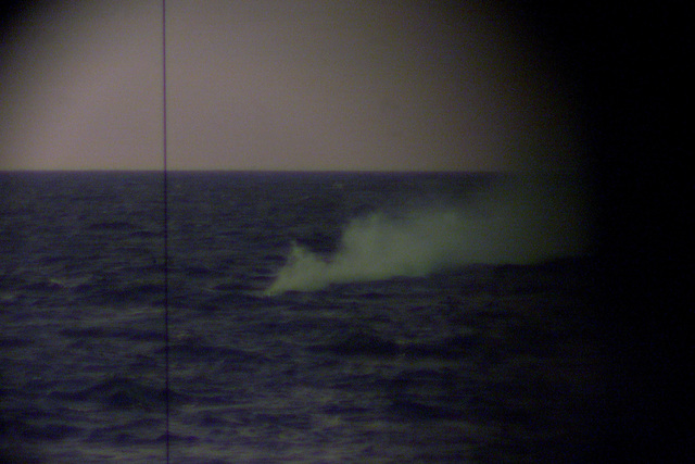 A smoke signal launched from the fast attack submarine USS TUCSON (SSN 770), as seen through its periscope, indicates to the other participants in Exercise TEAMWORK SOUTH '99 that an attack by the sub has taken place while off the coast of Chile