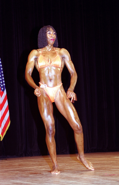 Michelle Dingle-Pemberton strikes a pose during the finals of the 9th annual Northern Japan Bodybuilding Championships. Dingle-Pemberton was named the overall Women's champion while taking top honors in the women's heavyweight division. Nearly 40 competitors from Misawa Air Base and the Misawa City community participated in the competition held at the Misawa Civic Center. Approximately 1,500 people from the base and surrounding communities attended the championship finals
