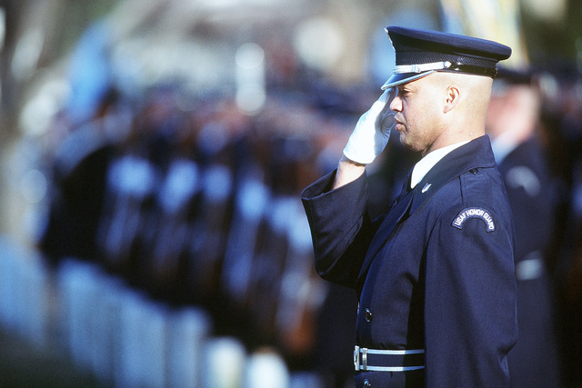 "inside back cover photograph of Technical Sergeant Michael A. Jones rendering a sharp salute. He is the NCOIC Charlie Flight, USAF Honor Guard. Photograph is part of the article in the August 1999 AIRMAN Magazine ""Air Force: Your Way of Life."""
