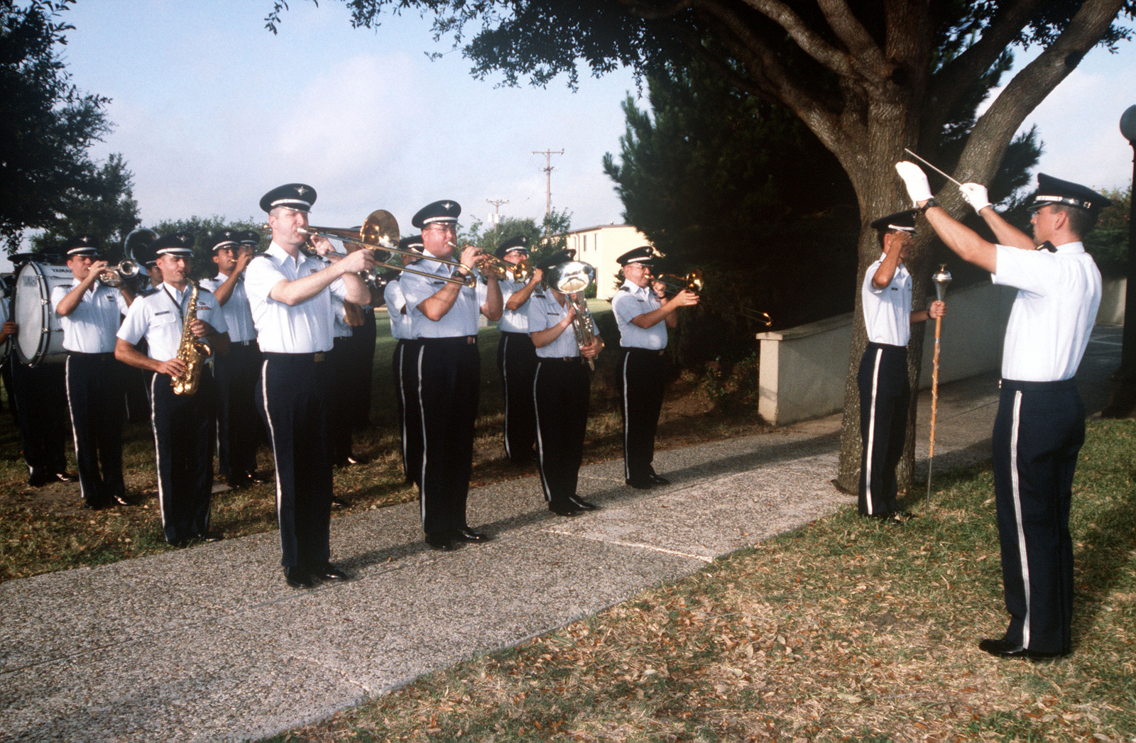 The United States Air Force Band of the West, from Lackland Air Force Base, Texas, play the National Anthem during the 311th Human Systems Wing Change of Command at Brooks Air Force Base, Texas