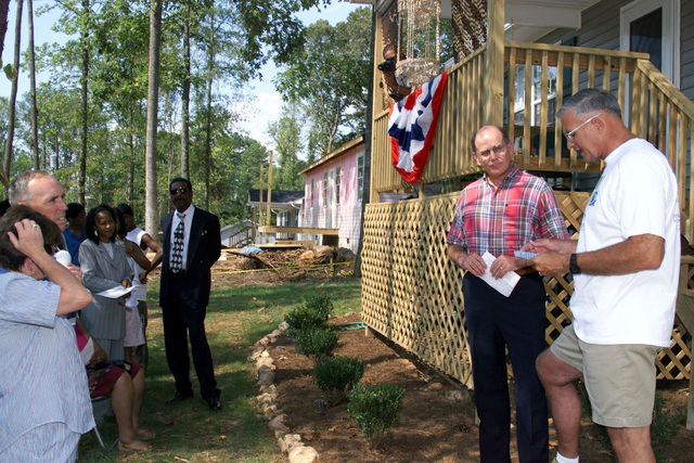 990815-A-2682N-014US Army General Thomas A. Schwartz, Commanding General, Forces Command, addresses the crowd, as Charlie Gray, Resources Committee Chairman, Southern Crescent Habitat for Humanity, looks on during a Dedication Ceremony. The Dedication Ceremony is for the house that the US Army Association Foundation and The Department of Defense Community (Fort McPherson/Fort Gillem) sponsored through Habitat for Humanity, for Mrs. Anne Boddie of Trinity Park, Riverdale, Georgia