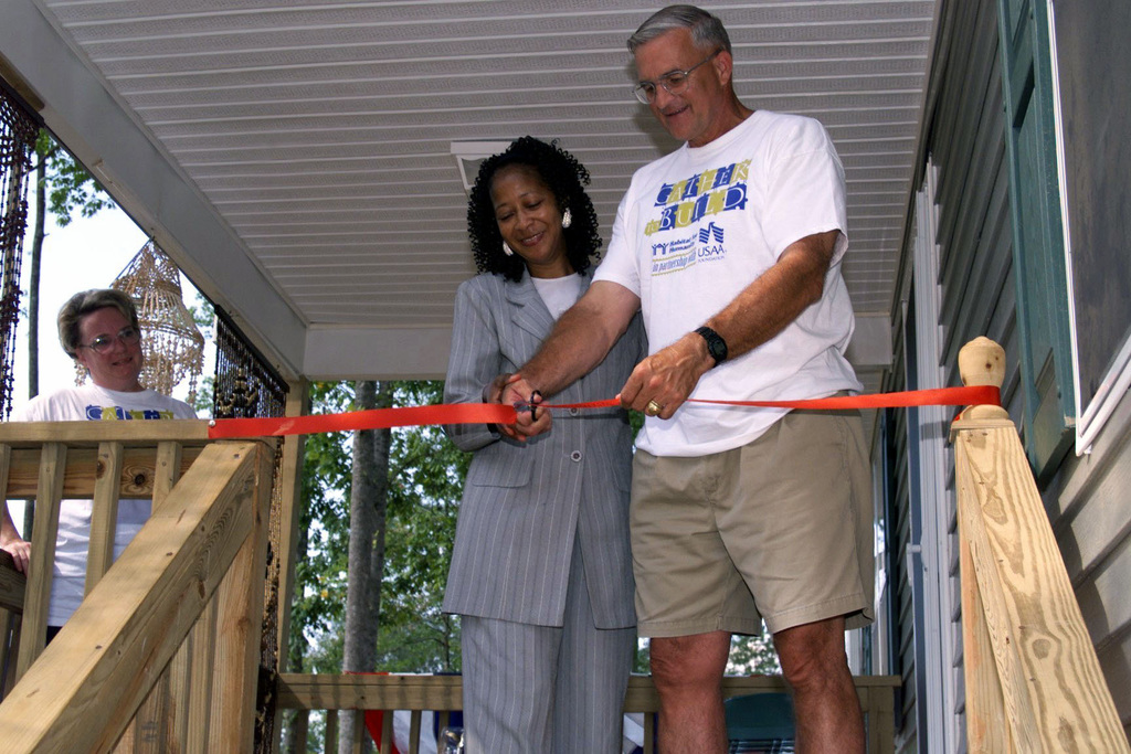 US Army General Thomas A. Schwartz, Commanding General, Forces Command, and Mrs. Anne Boddie of Trinity Park, Riverdale, Georgia cut the ribbon on her new house during the Dedication Ceremony. The Dedication Ceremony is for the house that the US Army Association Foundation and The Department of Defense Community (Fort McPherson/Fort Gillem) sponsored through Habitat for Humanity, for Mrs. Anne Boddie