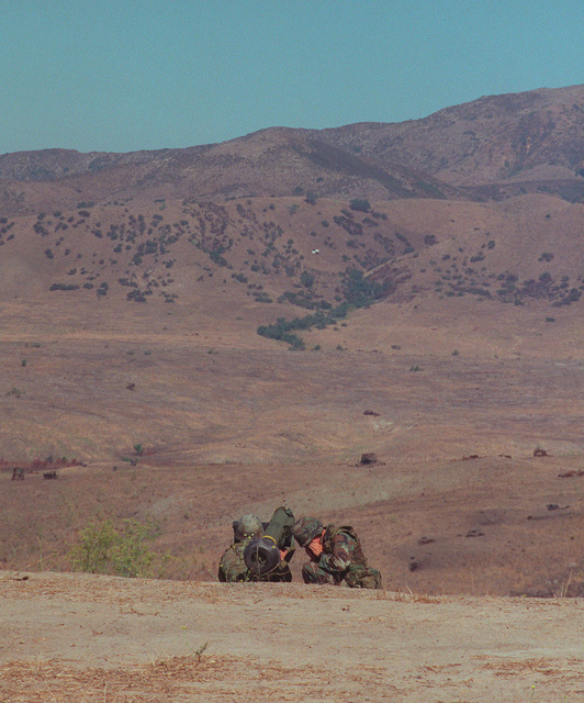 A view from the rear as US Marine Corporal L. Dillion and Lance Corporal A. Danielson, from the 3rd Battalion, 1ST Marines Anti-Armor Platoon fired the first Javelin missile. The missile can be seen in the center of the image. The target is an M60 Tank (Not shown), at 15-hundred meters was sited in by the Enhanced Thermal Signature created by the charcoal on the tank's engine block and tracks. The Javelin round was fired at Range 407 live fire range, Camp Pendleton, California June 19, 1999
