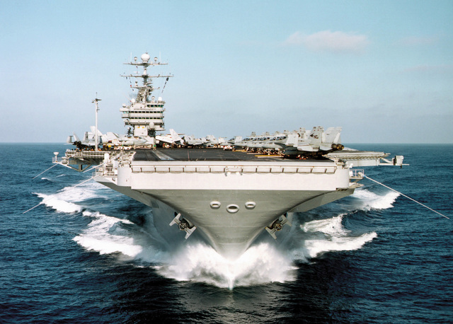 The aircraft carrier USS JOHN C. STENNIS (CVN 74) plows through the calm Pacific waters off the coast of Southern California at 28 knots during Competitive Training Exercise (COMPTUEX) August 22, 1999