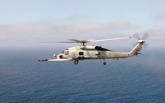 """A SH-60 """"Seahawk"""" attached to Light Helicopter Anti-Submarine Squadron Four Seven (HSL-47) fires an AGM-114B """"Hellfire"""" missile on a training evolution off the coast of San Clemente Island, California. An evolution is a cycle of training within an exercise"""