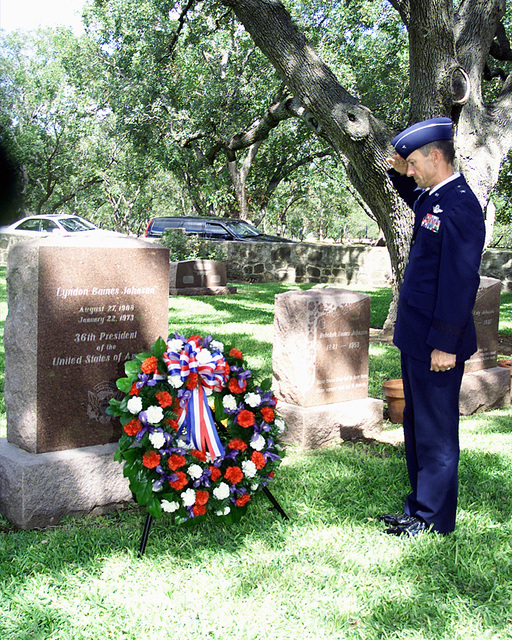 "Medium shot, left side view, Brigadier General Lawrence H. Stevenson, USAF, Commander, 12th Flying Training Wing, Randolph Air Force Base, Texas lays a memorial wreath at the grave of former U.S. President Lyndon Baines Johnson August 27, 1999. The memorial service held at the LBJ Ranch near Johnson City, Texas commemorated the 91st anniversary of the 36th President's birthday. Former First Lady, ""Lady Bird Johnson"" (Not shown) was hostess of the event"