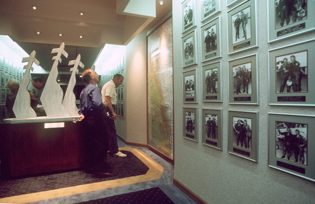 """Inside Atterberry Hall, 560th's headquarters, Randolph Air Force Base, Texas, visitors can look at photos showing every freedom flier in the program's 26-year history. This photograph is part of the article """" Freedom Flight"""", AIRMAN Magazine, September 1999 issue"""