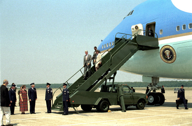 Medium long shot, left front view, President William Clinton and Arkansas Senator Blanche Lincoln on passenger stairs from a VC-25 Air Force One, Little Rock Air Force Base, Arkansas