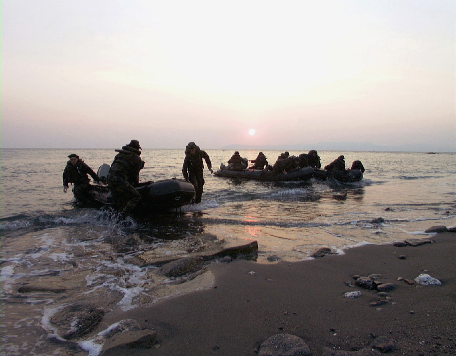 Marines from 1ST Platoon, Lima Company, Battalion Landing Team, 3rd Battalion, 8th Marine Regiment, silently approach the beach in the twilight at dusk.Marines from the 26th Marine Expeditionary Unit (Special Operations Capable) (MEU(SOC)), embarked aboard the USS PONCE (LPD-15), are participating in the NATO exercise, NORTHERN APPROACH, with British and Turkish forces