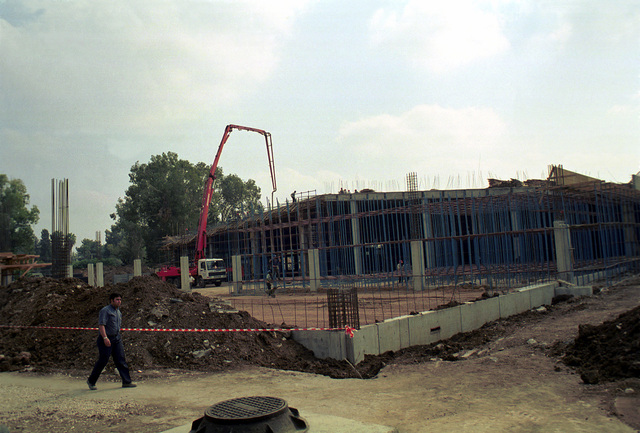 Straight on medium exterior shot of the new Base Exchange at Incirlik Air Base Turkey in Phase 2 of construction. The Base Exchange construction cost is 2.7 million dollars and construction will be completed in April 2000. The grand opening is scheduled for July 2000